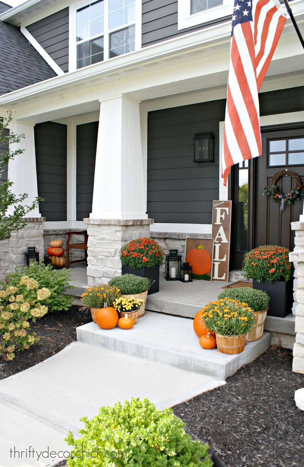 Modern Craftsman porch decorated for fall
