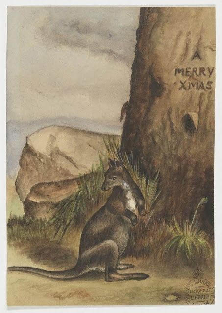 """Christmas Card design depicting a rock wallaby at the base of a tree with the words """"A Merry Xmas"""" engraved in the tree."""