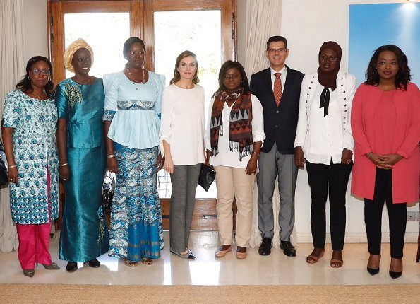Queen Letizia wore Massimo Dutti large plaid trousers at Women for Africa Foundation meeting in Dakar