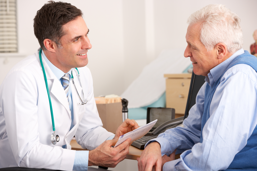 Doctor consults with older male patient