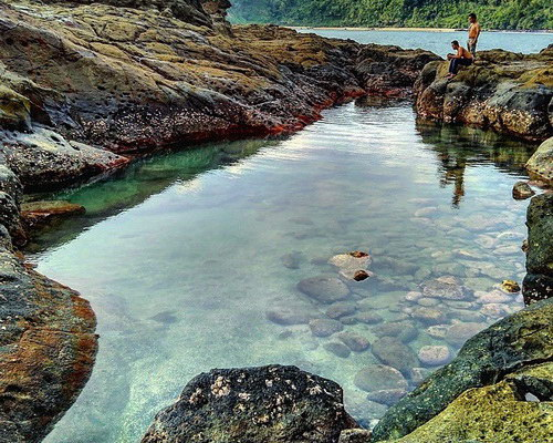 www.Tinuku.com Wediombo beach in Gunung Kidul, the hidden paradise for surfing and snorkeling on white sand and coral reefs