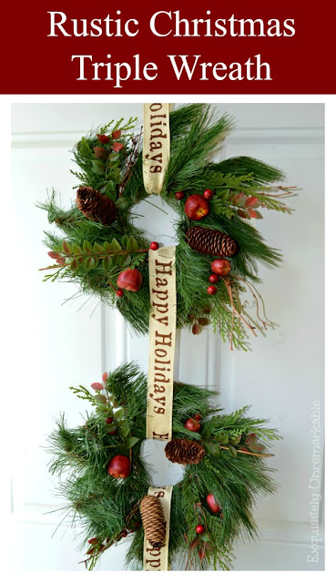 Two green holiday wreaths on a white door