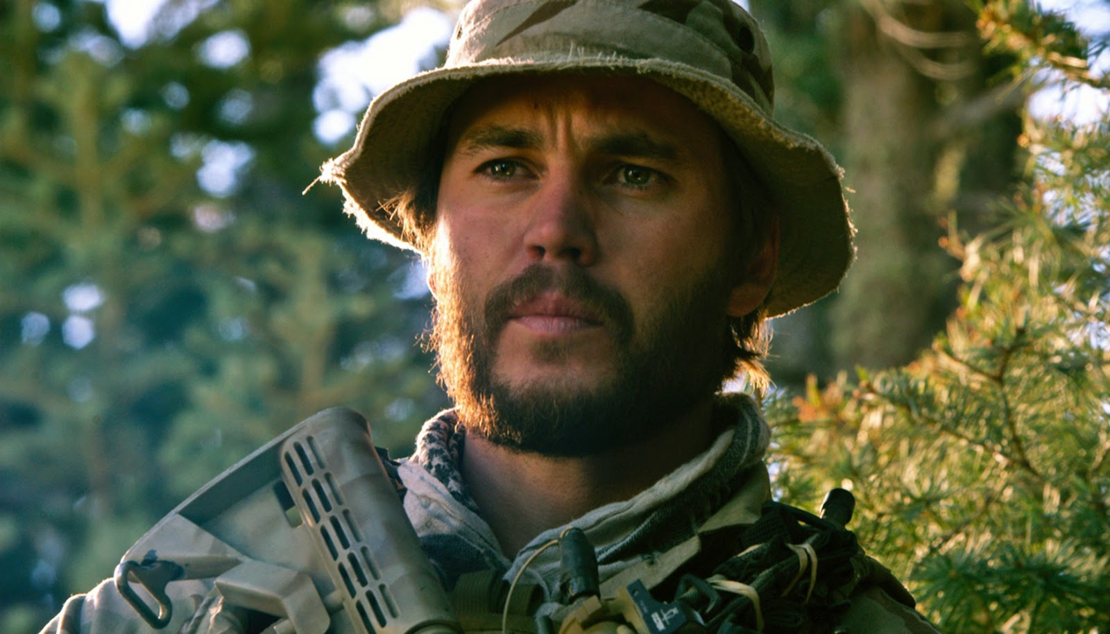 "Taylor Kitsch Plays Real-Life Navy SEAL Hero in ""Lone ..."