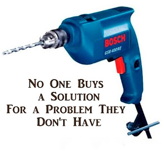 drill and drill bit with phrase no one buys a solution for a problem they don't have