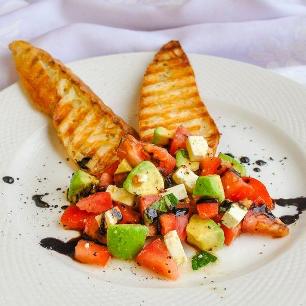 Tomato Avocado Feta Crostini