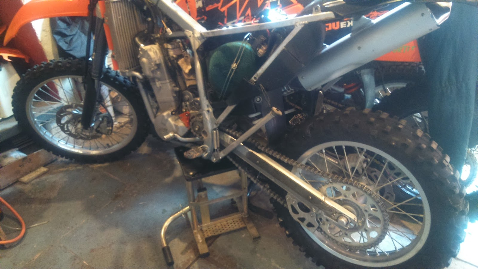 Once I'd got the bike home, it was strip down time and out came the usuals,  spark plug, air filter, oil filters, oil, coolant, and all the brake fluids  and ...