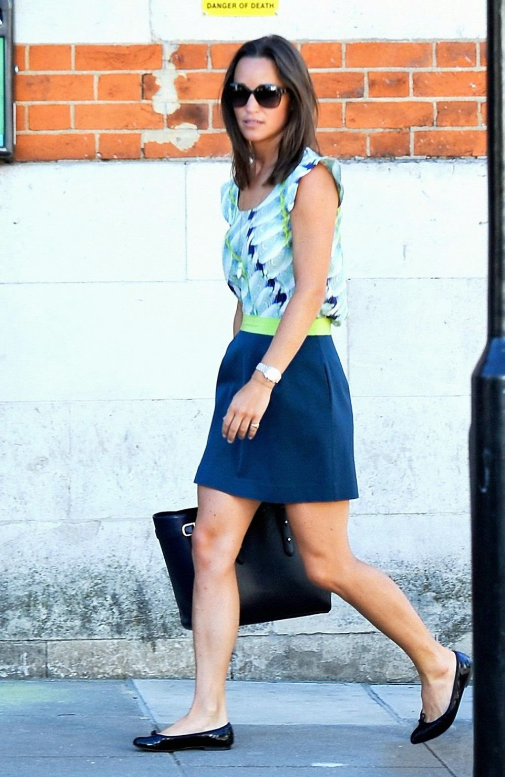 Pippa Middleton in a navy skirt out and about in London