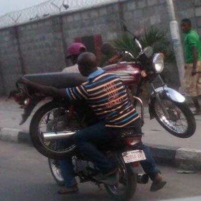 Photos: Okada Rider Carries Another Rider & His Bike
