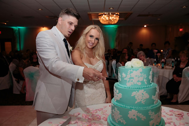 bride and groom cake cutting at Fern Hill Golf Course
