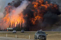 The 2016 Fort McMurray wildfire in eastern Alberta. (Credit: The Premier of Alberta/flickr) Click to Enlarge.