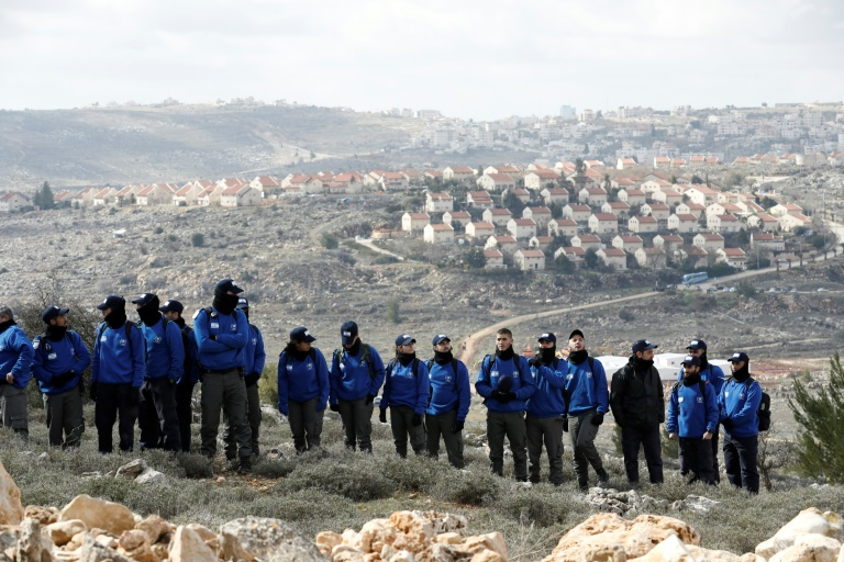 Israeli security forces gather at the Amona outpost, northeast of Ramallah, as they prepare to evict hardline Jewish occupants of the wildcat settlement outpost