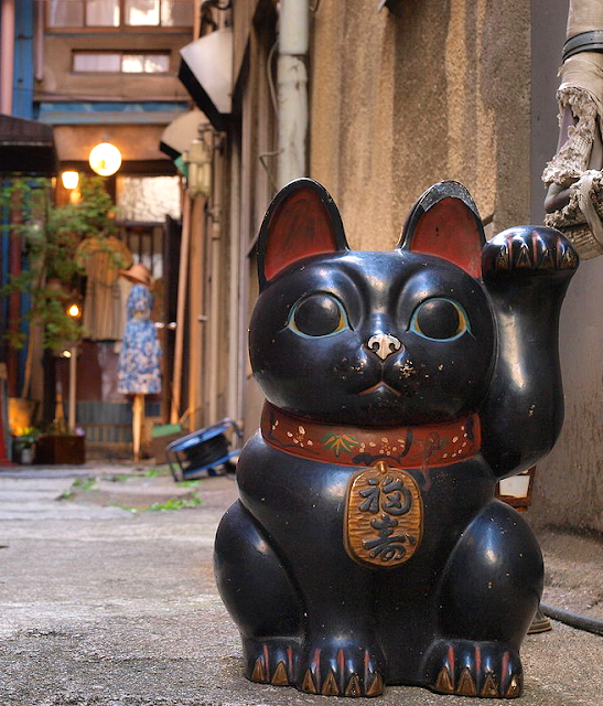 Maneki Neko in street in Japanese village