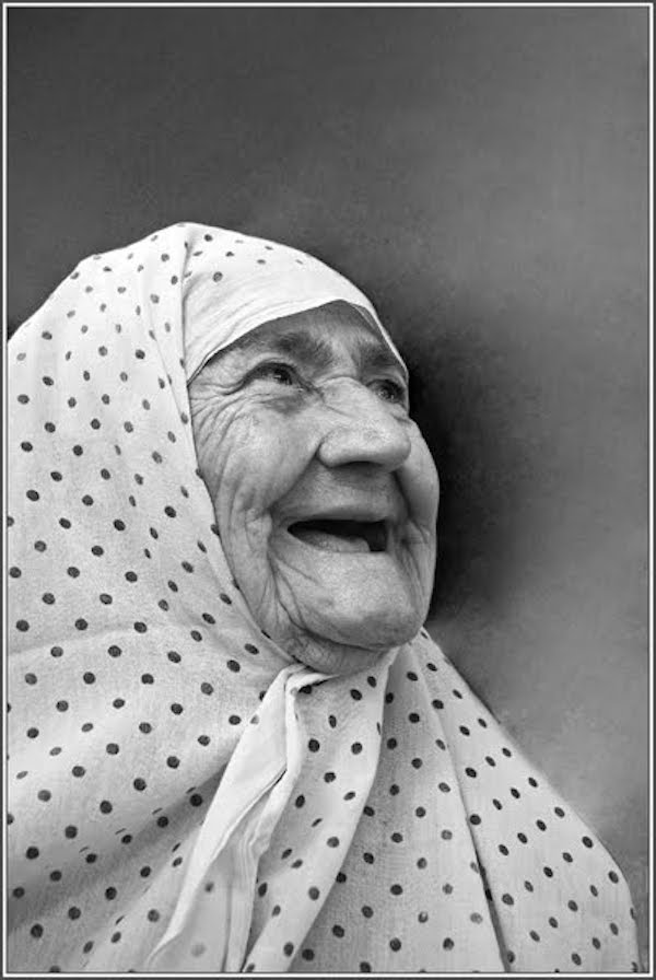 Gorgeous black and white photo of laughing senior lady wearing a headscarf April Fool. MarchMatron.com