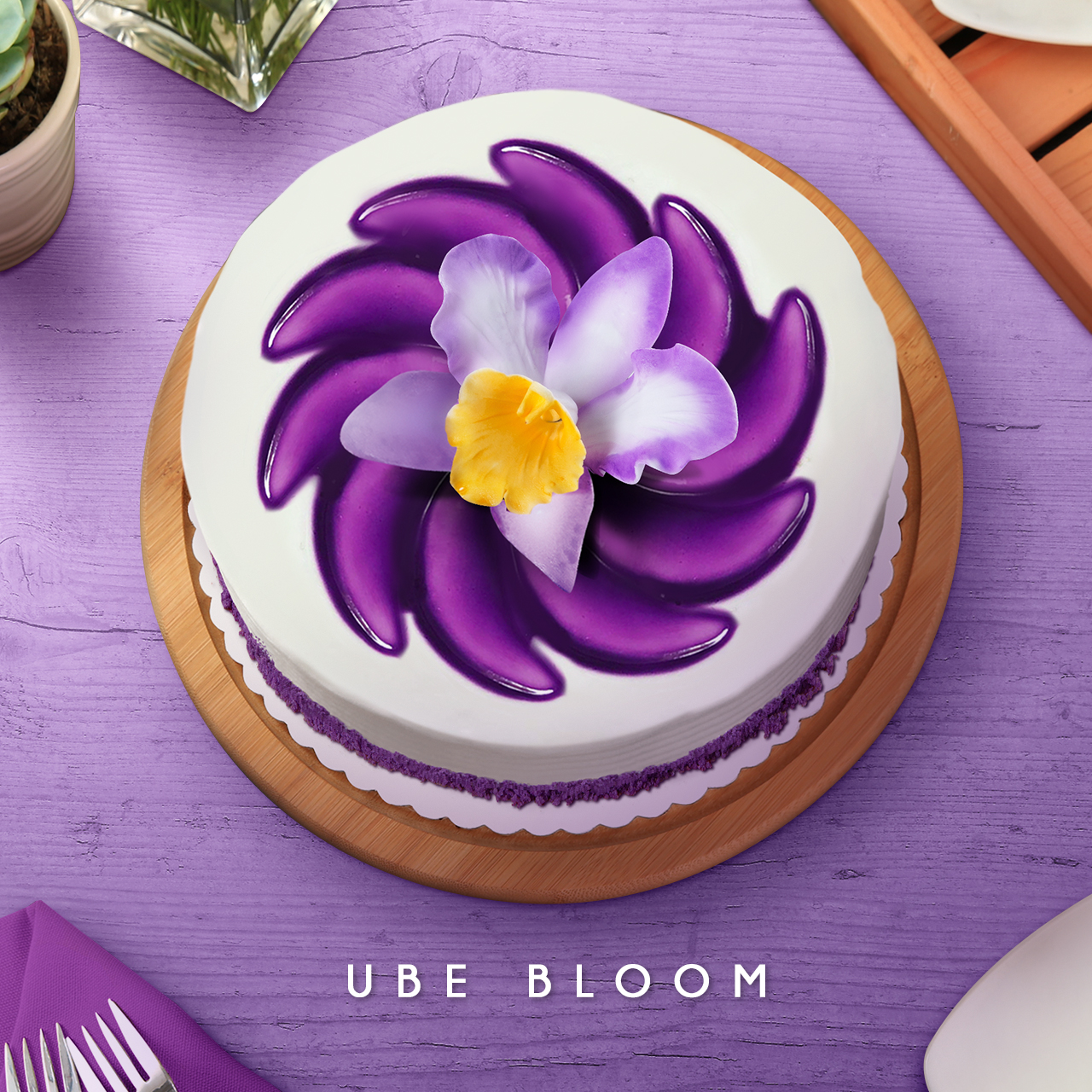 8327c0b6dbab Cakes of Art The Ube Bloom is a feast for the eyes and the taste buds. The  sumptuous cake is covered with creamy, snow-white frosting and embellished  with ...