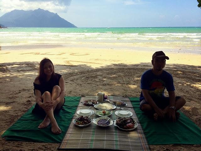 Monnette Santillan eating by the beach