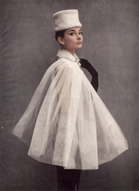 Audrey Hepburn wearing a cape