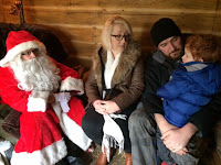Mummy, Daddy and son talking to Santa