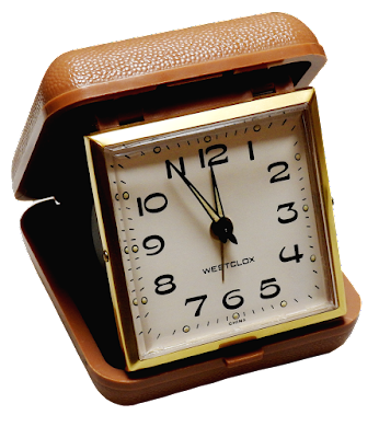 A vintage travel alarm clock that folds up.