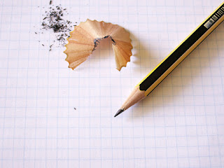 An image of a pencil and pencil shavings on a blank sheet of paper; intended to show GED test takers the difference between kinda-sorta wanting something and really desiring it.
