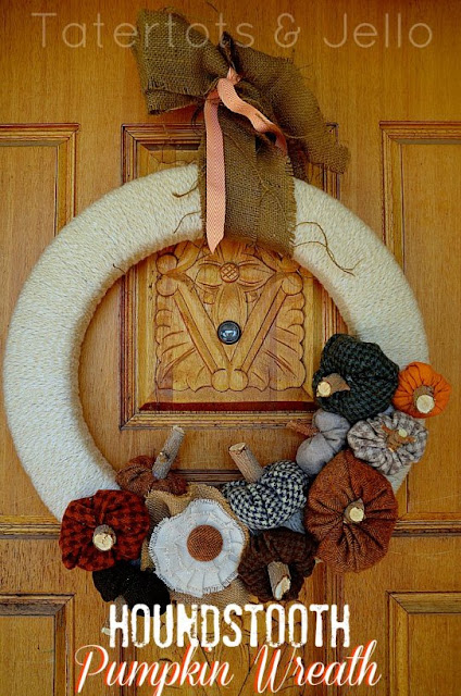 This fabric wreath with pumpkins on it is a great fall front door decor piece.