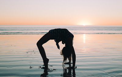 Picture of a girl doing yoga at the beach