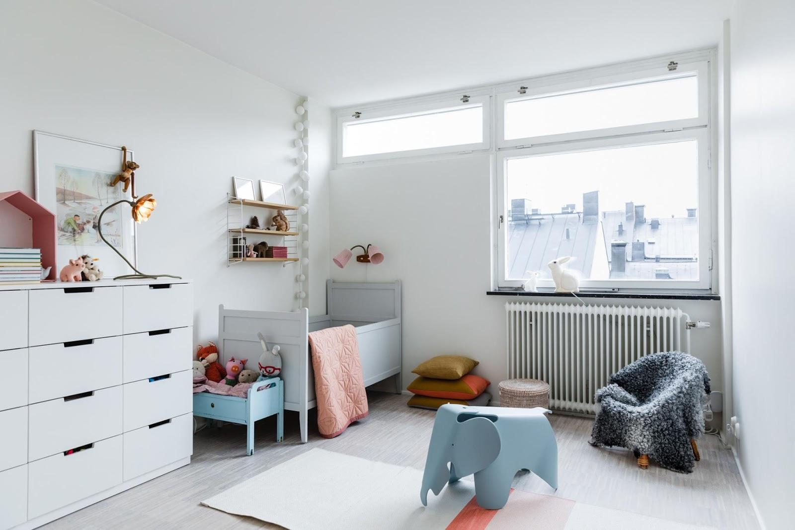 stylish nursery in scandinavian home