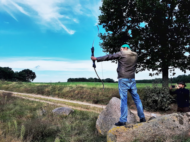 The Social Traveler aiming his bow in nature of Mecklenburg-Vorpommern