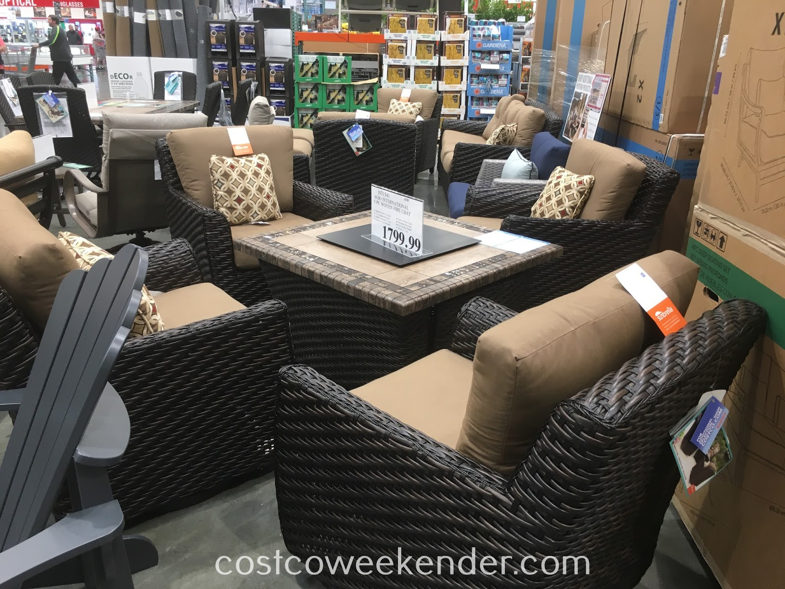 Lounge outside and stay warm with the Agio International 5pc Woven Fire Chat Set