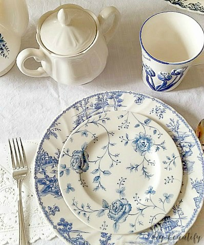 I've an avid dish collector and some of my favorites are my blue and white dishes. Although mismatched, they look beautiful together on this Spring table! Find out more at diy beautify!