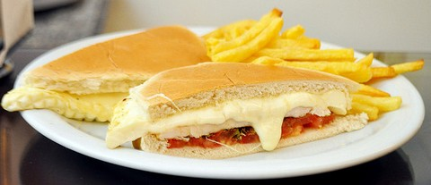 Chicken Sandwich With Cheese And Grilled Tomatoes