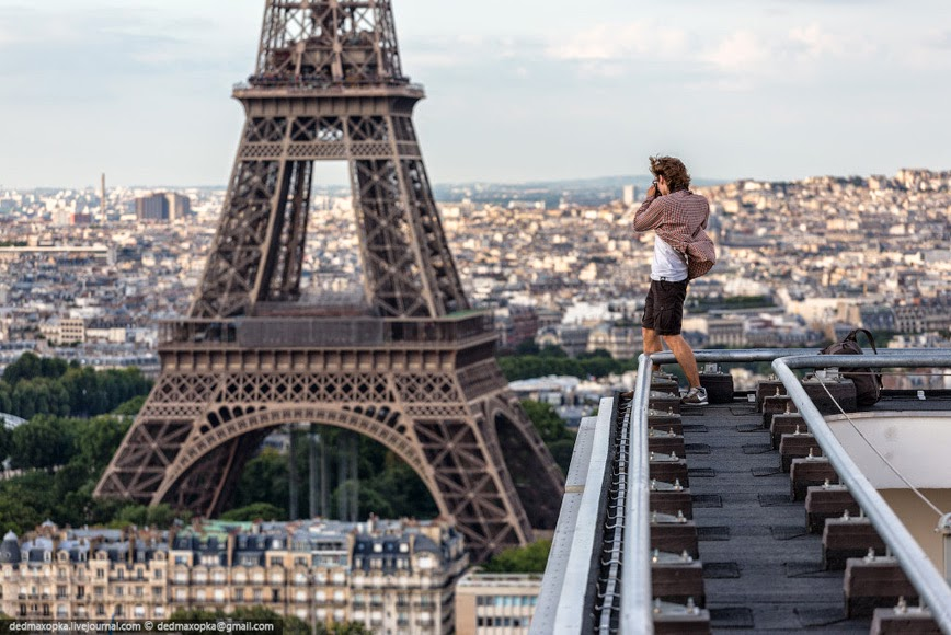 27. Urban Climbing in Paris –  Paris, France - 27 Amazing Travel Photos That Will Infect You With The Travel Bug