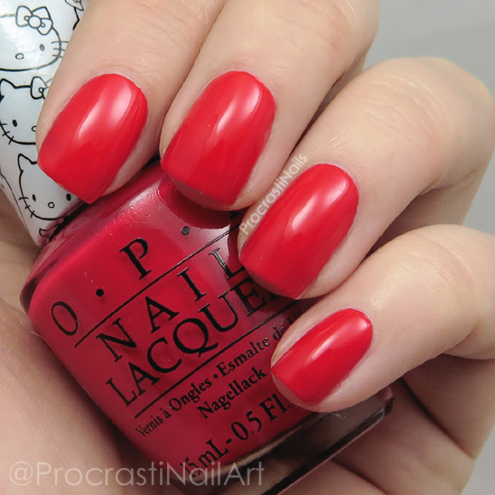 Swatch of the red nail polish OPI 5 Apples Tall