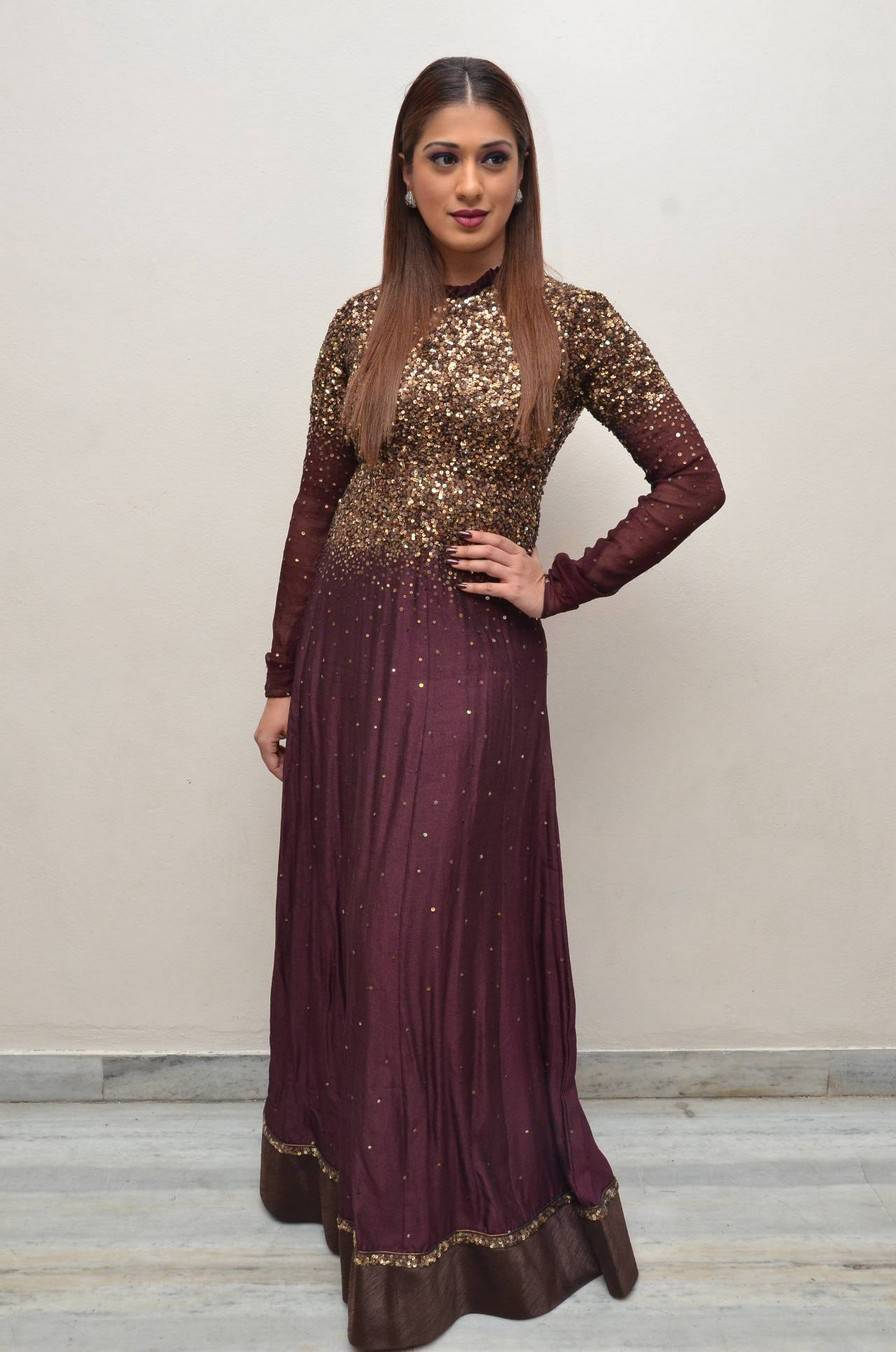 Indian Actress Raai Lakshmi Long Hair Hot In Maroon Dress At Audio Launch