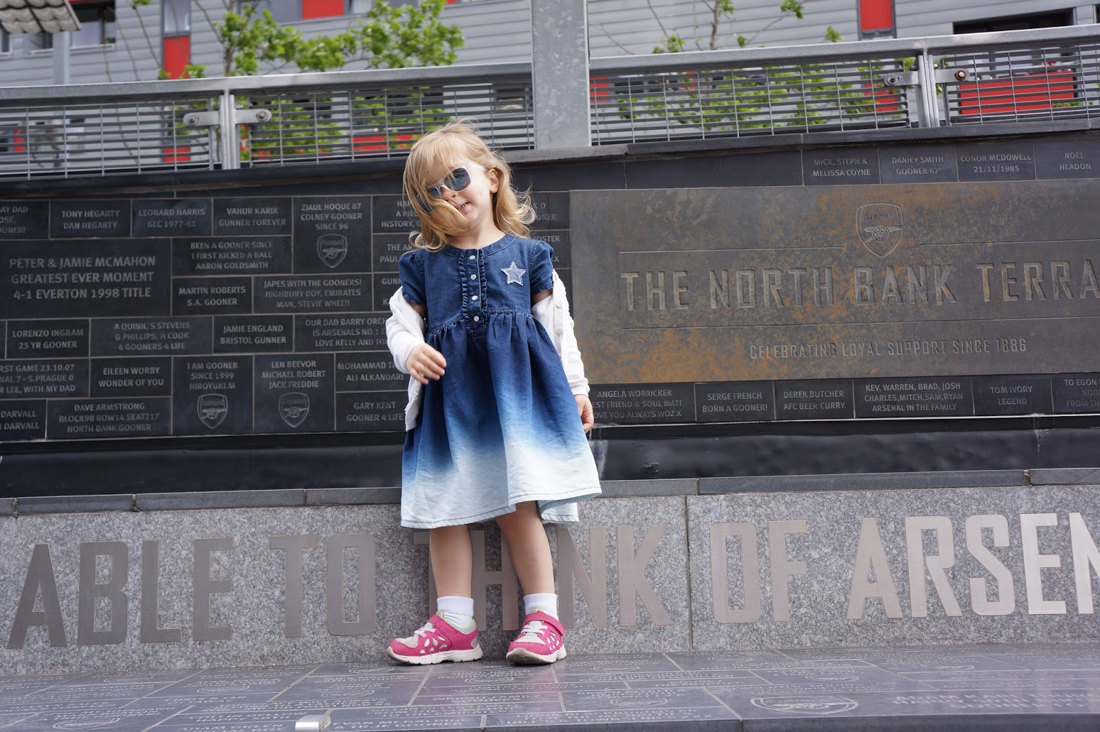 toddler wearing a dip dye denim dress