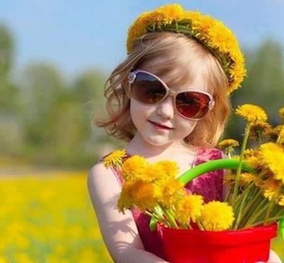 Baby Girl with Beautiful Yellow Flowers