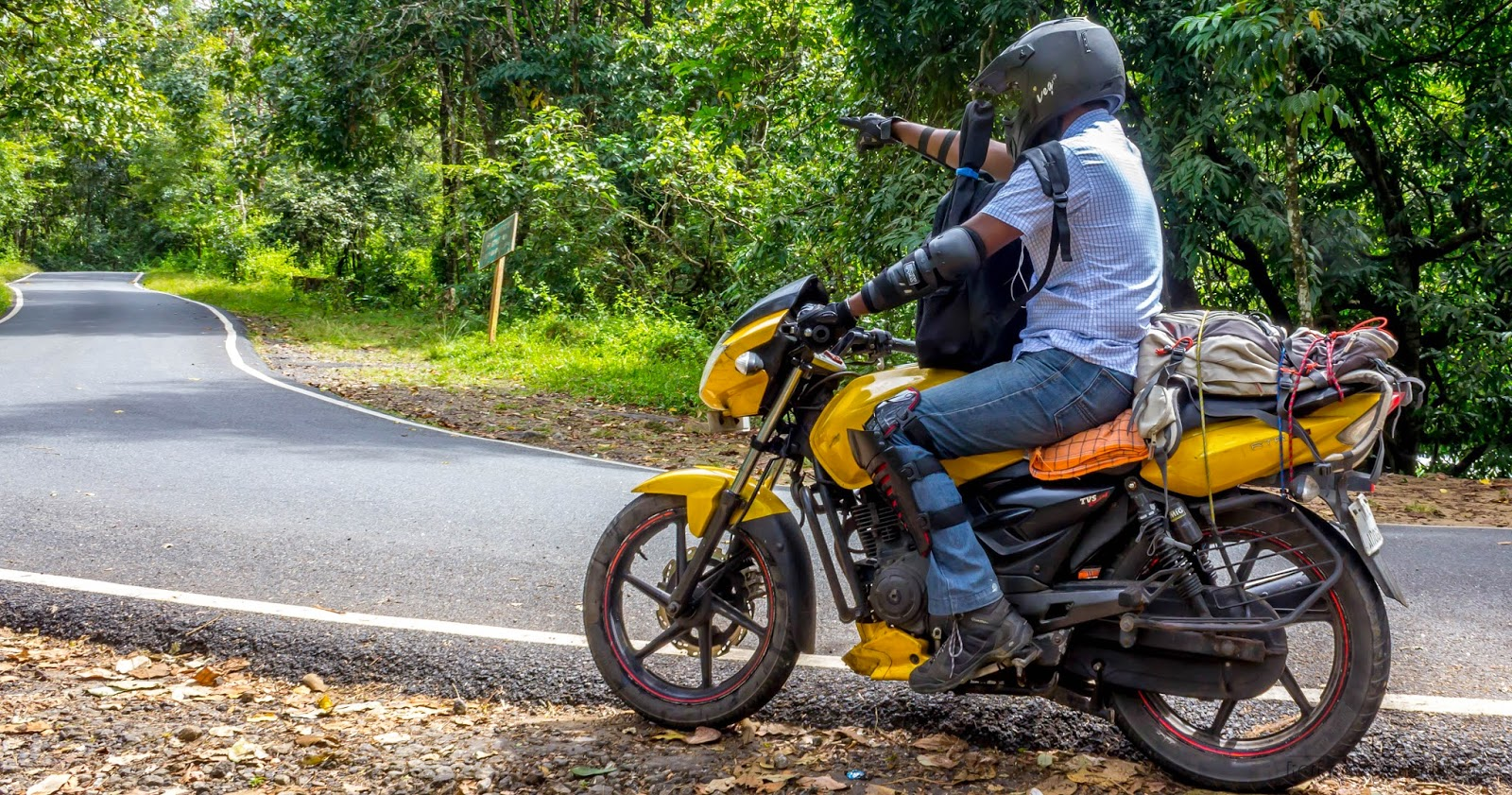 Way to Athirapally with biker pointing the direction