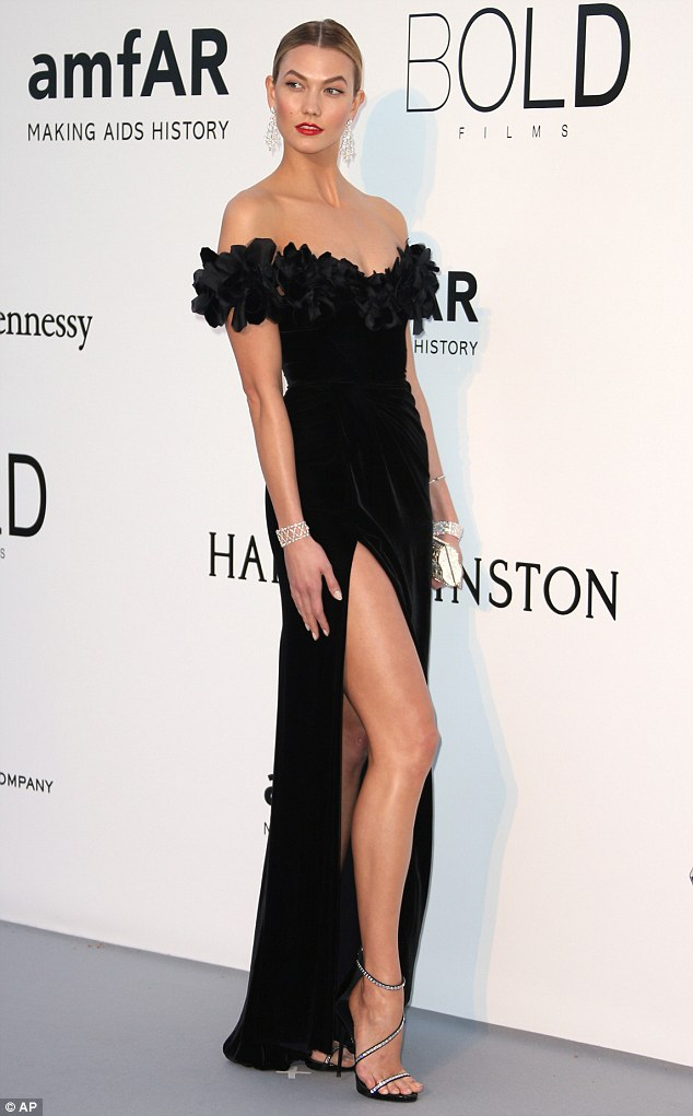 Karlie Kloss stuns on red carpet in thigh-high gown