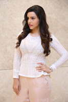 Kyra Dutt in Tight White Top Trousers at Paisa Vasool audio success meet ~  Exclusive Celebrities Galleries 026.JPG