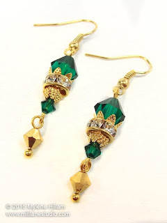 Swarovski emerald and gold drop earrings for special occasions and bridal wear