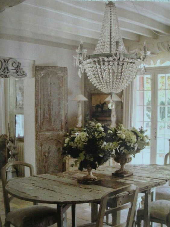 Decor inspiration: Rustic #Frenchfarmhouse dining room with weathered wood table and shutters on Hello Lovely Studio