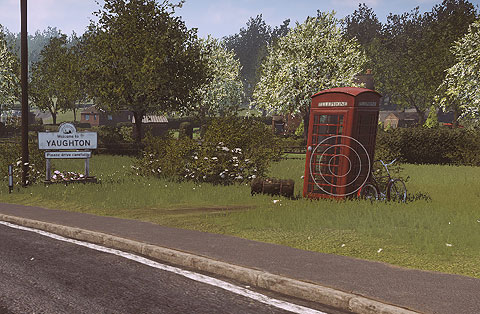 Image of a telephone box in the green village of Yaghton. Three concentric circles in white overlay the telephone box, to indicate that sound is coming from this area.