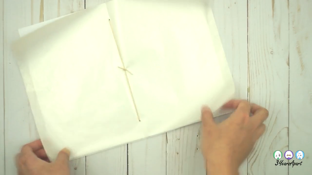 An open-to-the-center DIY wax paper TN insert showing the end result of sewing / bookbinding with twine.