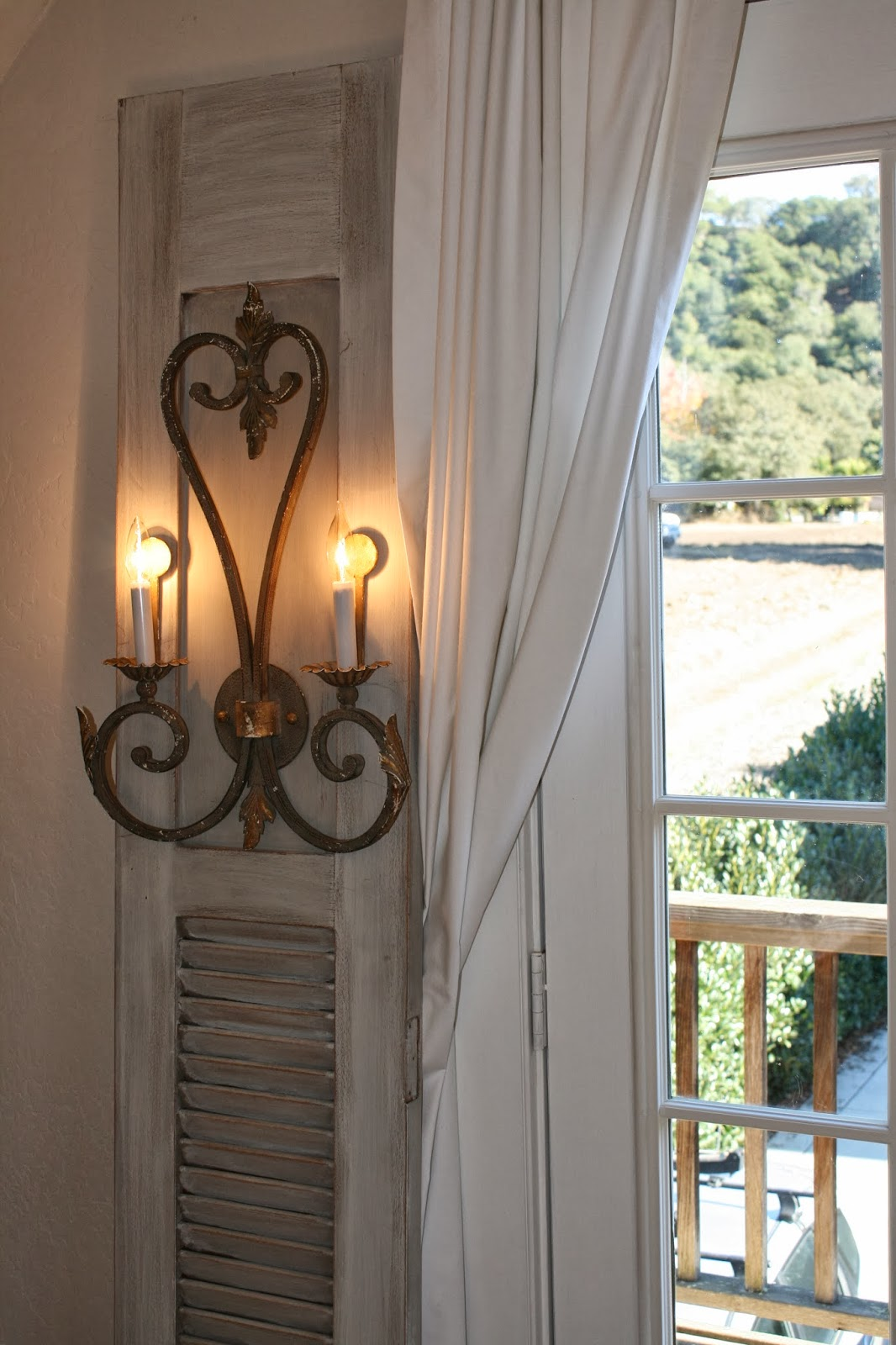 Reloved Rubbish Wall Sconces On Old Shutter Doors