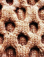 http://www.ravelry.com/patterns/library/the-honeycomb---the-cowl-neckwarmer