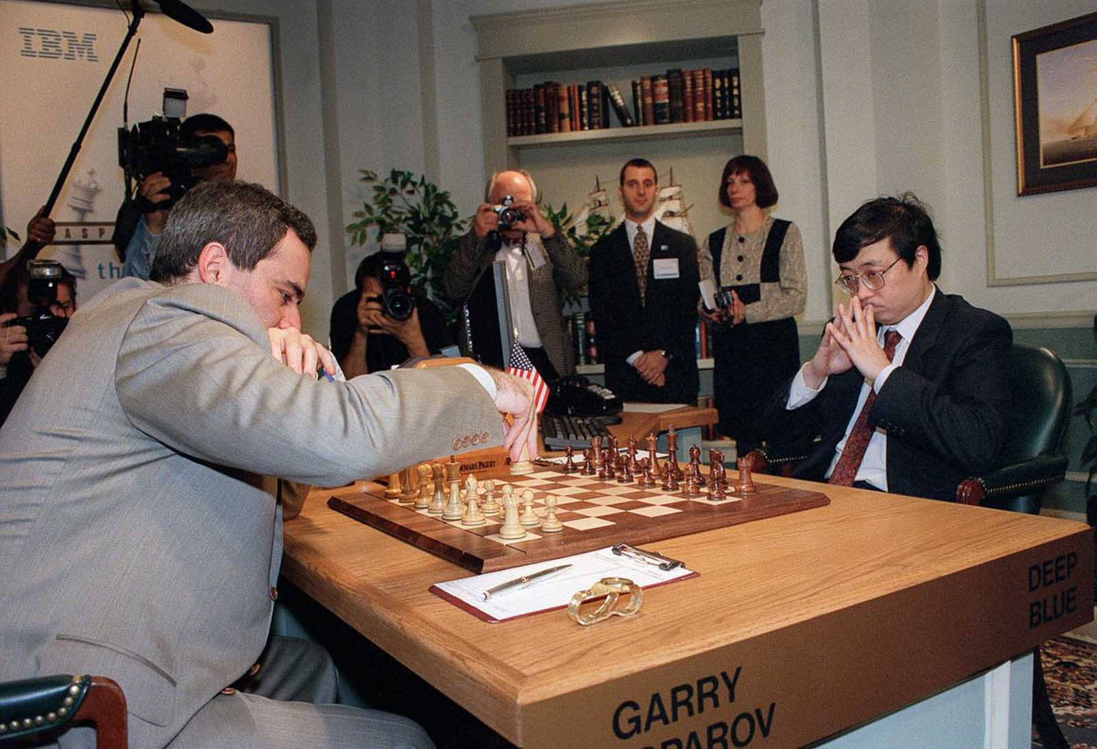 Kasparov moves his first piece, a knight, in the first game of the rematch.