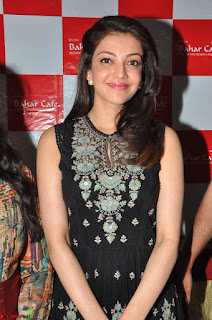 Kajal Aggarwal in lovely Black Sleeveless Anarlaki Dress in Hyderabad at Launch of Bahar Cafe at Madinaguda 042.JPG