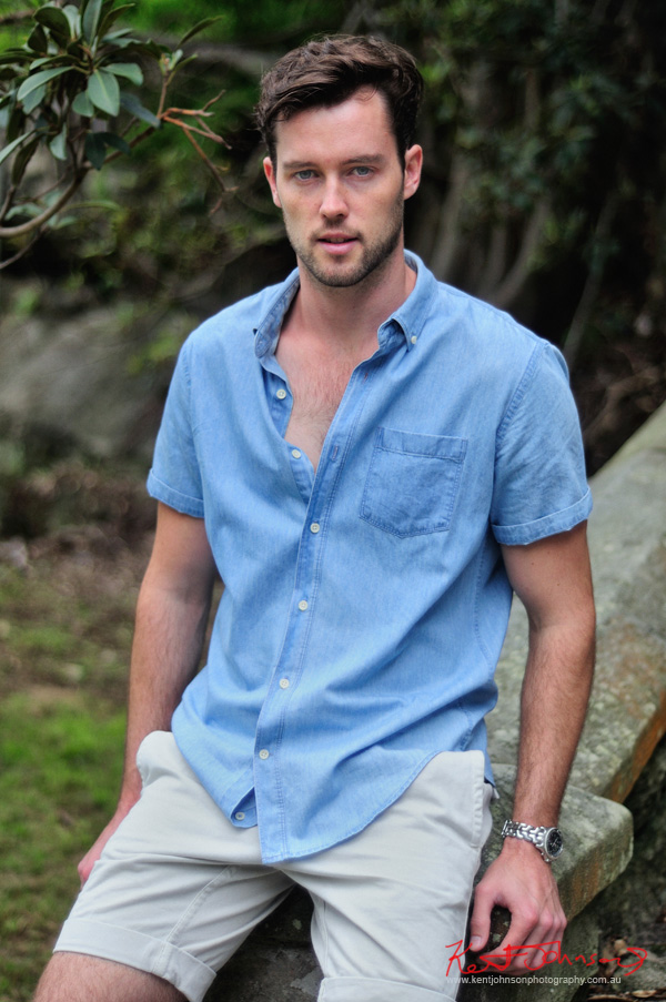 Casual in shorts and blue shirt on location. Male modelling portfolio by Kent Johnson, Sydney, Australia.