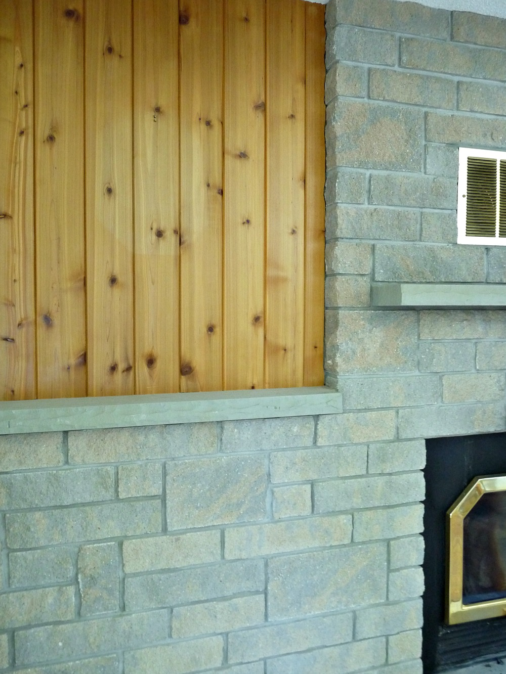 Concrete and pine fireplace