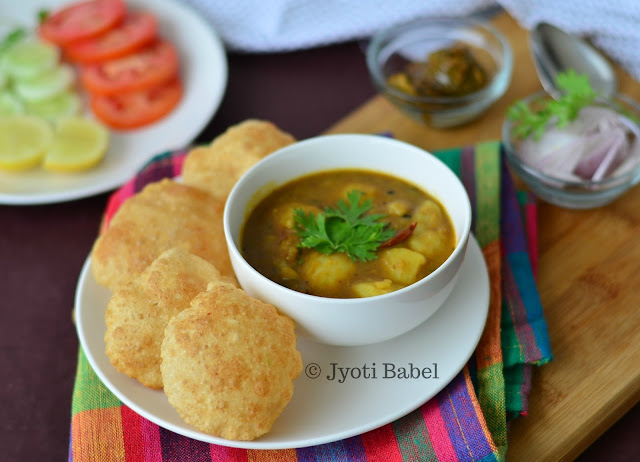 Club Kachori is a quite a famous weekend breakfast dish from the city of Kolkata. These are bite sized puri served with spicy potato curry. Find the recipe on www.jyotibabel.com