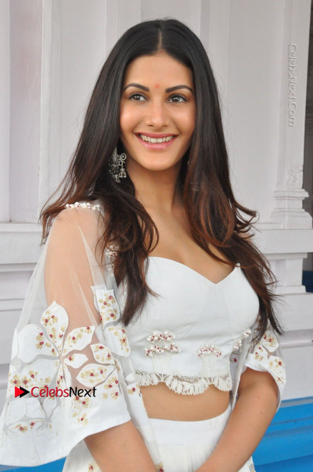 Amyra Dastur Stills in White Skirt and Blouse at Anandi Indira Production LLP Production no 1 Opening